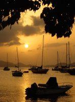 Sunset over sea and sailboats St. John, USVI, Caribbean