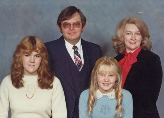 """""""Before;"""" Me as a proper Southern girl in a monogrammed sweater and lace collar, with my family circa (cough, cough)."""