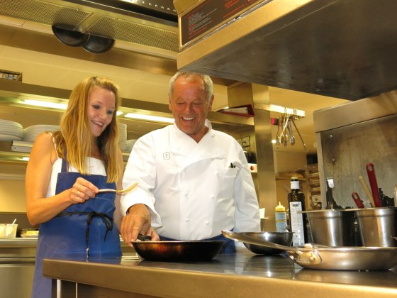Wolfgang Puck at a stove in the kitchen of London's 45 Park Lane Hotel.
