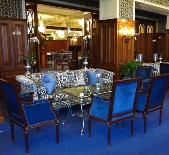 Ashford Castle's Drawing Room, newly swathed in blue velvet, offers a glimpse into the George V dining room.