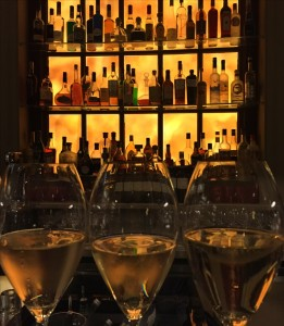 glasses of champagne lines up at Swan Bar at Maison Assouline, 196A Piccadilly, London