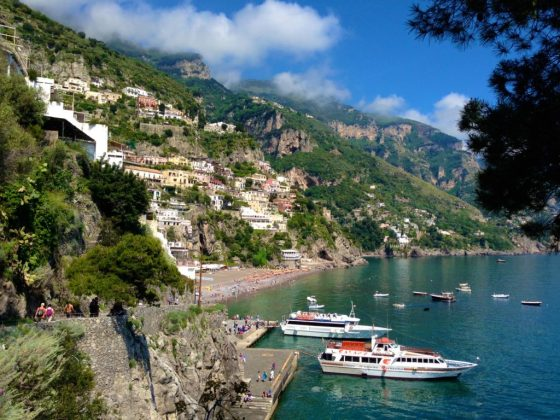 Positano, Italy path from Spiaggia di Fornillo towards Spiaggia Grande, overlooking beautiful blue-green bay