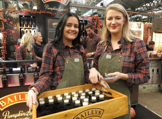 two girls holding tray of Bailey's Pumpkin Spice liqueur