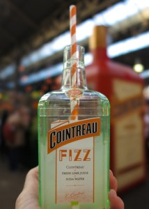 Cointreau Fizz with Cointreau pop-up kiosk in the background