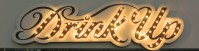 neon sign that reads Drink Up