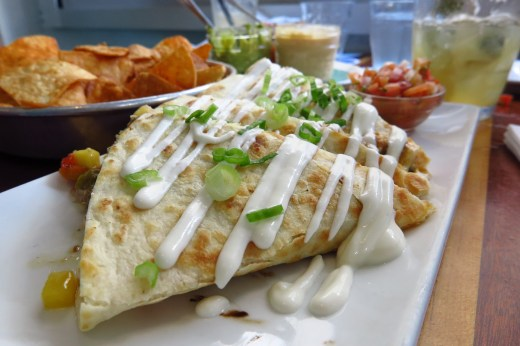 Try the braised pork belly mango pepper quesadillas at The Longboard in Cruz Bay, St. John. Copyright Amy Laughinghouse.