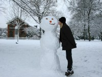 woman kisses snowman