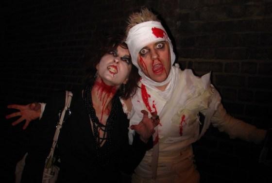 Halloween revelers coated in fake blood