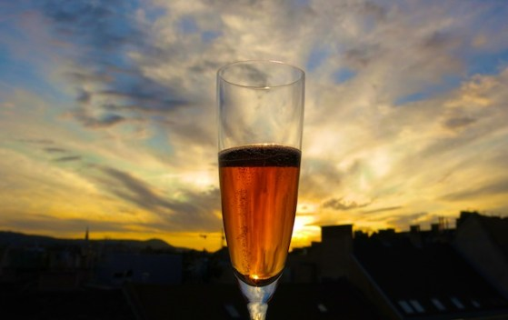 Toasting the sunset with the Aria's signature Andrea Rost cocktail, combining champagne, grapefruit peel and Grand Marnier.