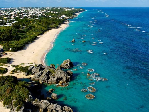 Clear teal-blue waters lap at Bermuda's coastline. Courtesy Bermuda Tourism.