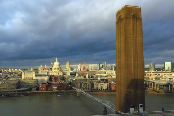 The viewing platform atop the Tate Modern's new Switch House wing overlooks the Thames River, taking in monuments like the Millenium Bridge and St. Paul's Cathedral beyond the gallery's iconic brick column. Copyright Amy Laughinghouse.
