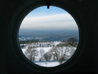 A porthole window view from Broadway Tower