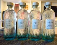 four bottles of Isle of Harris Gin lined up in a row
