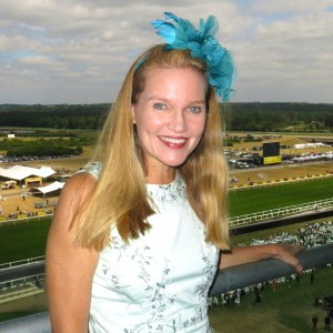 Amy Laughinghouse in a feathered fascinator at Royal Ascot.