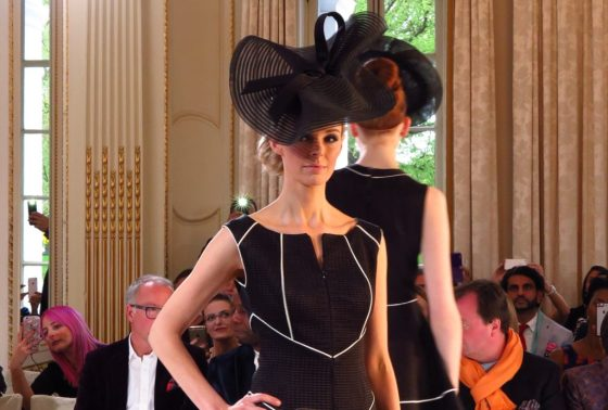 A black dress trimmed with white made a dramatic impression on the catwalk at Isabell Kristensen's 2017 Royal Ascot Couture Collection runway show.