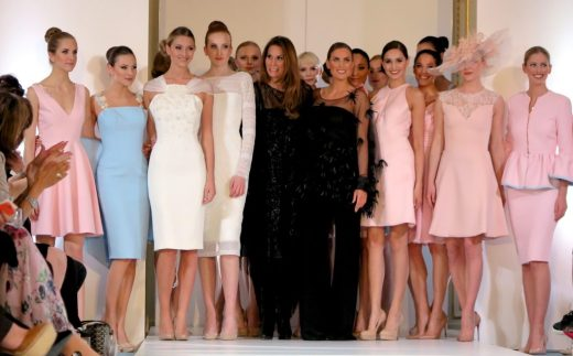 Designer Isabell Kristensen (sixth from left, in black) joins her models at the top of the catwalk following her 2017 Royal Ascot Couture Collection runway show in London.