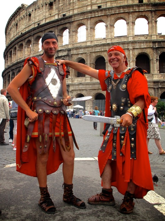 gladiators pose outside Colosseum in Rome