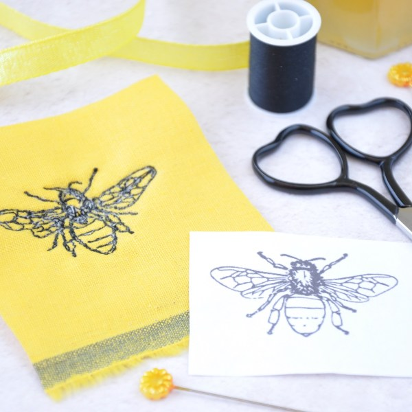 Embroidered bee and picture