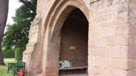 Gatehouse arch. The ancient bench has slots in it, possibly for spears.