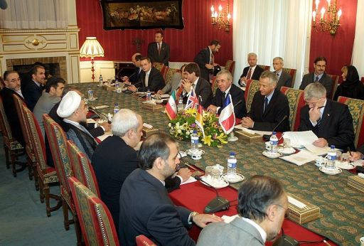 "Hassan Rouhani can be seen on the left-hand side of this picture (wearing the white turban) in his role as Iran's chief nuclear negotiator in a 2003 meeting with members of the ""E3"" (Britain, France, and Germany). Photo by Wikipedia user Mojtaba Salimi"