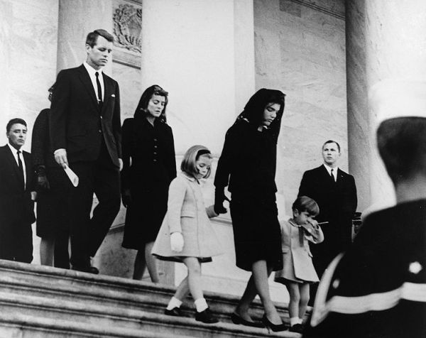 Jacqueline Kennedy leads her children out from her husband's funeral on November 25, 1963, followed by other members of the Kennedy family.  White House photo by Abbie Rowe