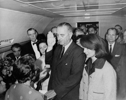 Lyndon B. Johnson taking the presidential oath of office on Air Force One.  White House photo by Cecil Stoughton