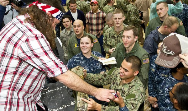 One of the Duck Dynasty stars greets members of  the military during the 2013 Chairman USO Holiday Tour earlier this month.  Flickr photo by USO
