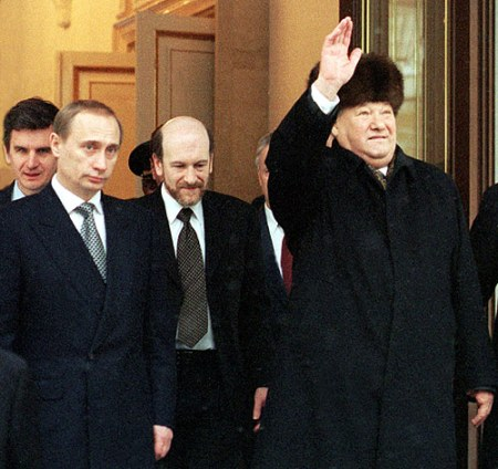 Putin (left) with outgoing President Boris Yeltsin (right, waving) on the day that he resigned - December 31, 1999. Official Russian presidency photo