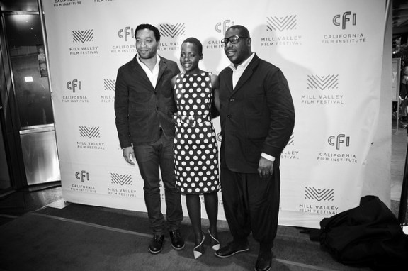 """Twelve Years a Slave"" stars Chiwetel Ejiofor (far left) and Lupita Nyong'o (center) with director Steve McQueen (far right) at the Mill Valley Film Festival. Flickr photo by Steve Rhodes"