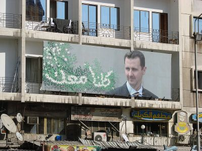Propaganda poster of Syrian President Bashar Al-Assad back in 2007. Photo by Wikipedia user watchsmart