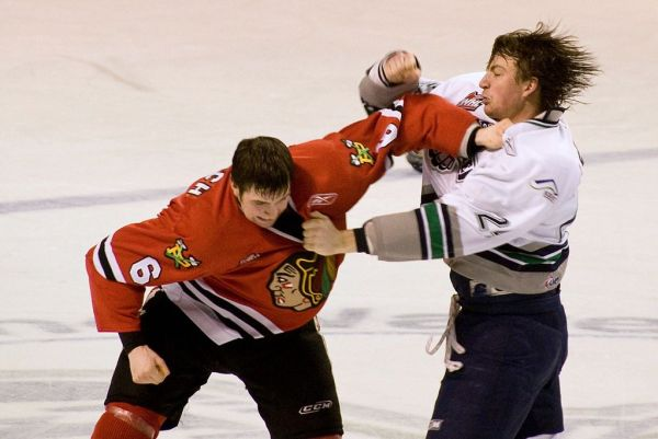 1024px-Fight_in_ice_hockey_2009