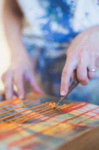 Amy Royce scraping encaustic paint