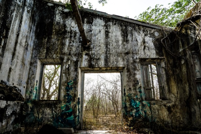 Abandoned ghost town where paranormal activity is reported.