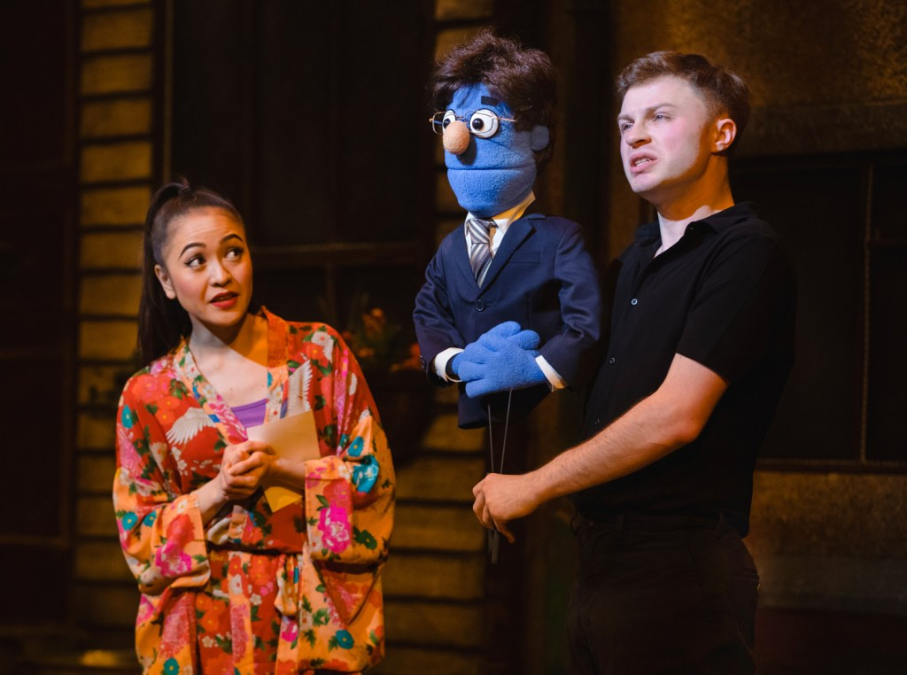 Saori Oda as Christmas Eve and Lawrence Smith as Rod in Avenue Q