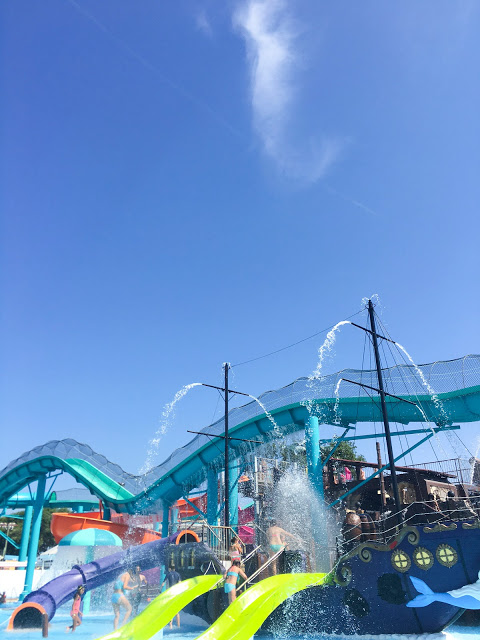 A giant ship spouts gallons of water on guests young and old.
