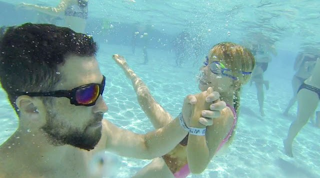 Father and daughter explore the underwater world of Adventure Landing's wave pool