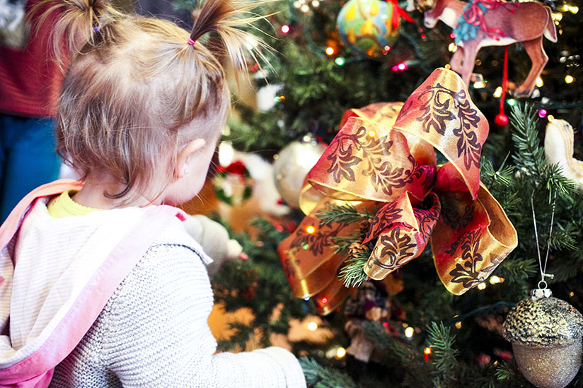 Toddler examines the Christmas Tree at Horse Stamp Inn