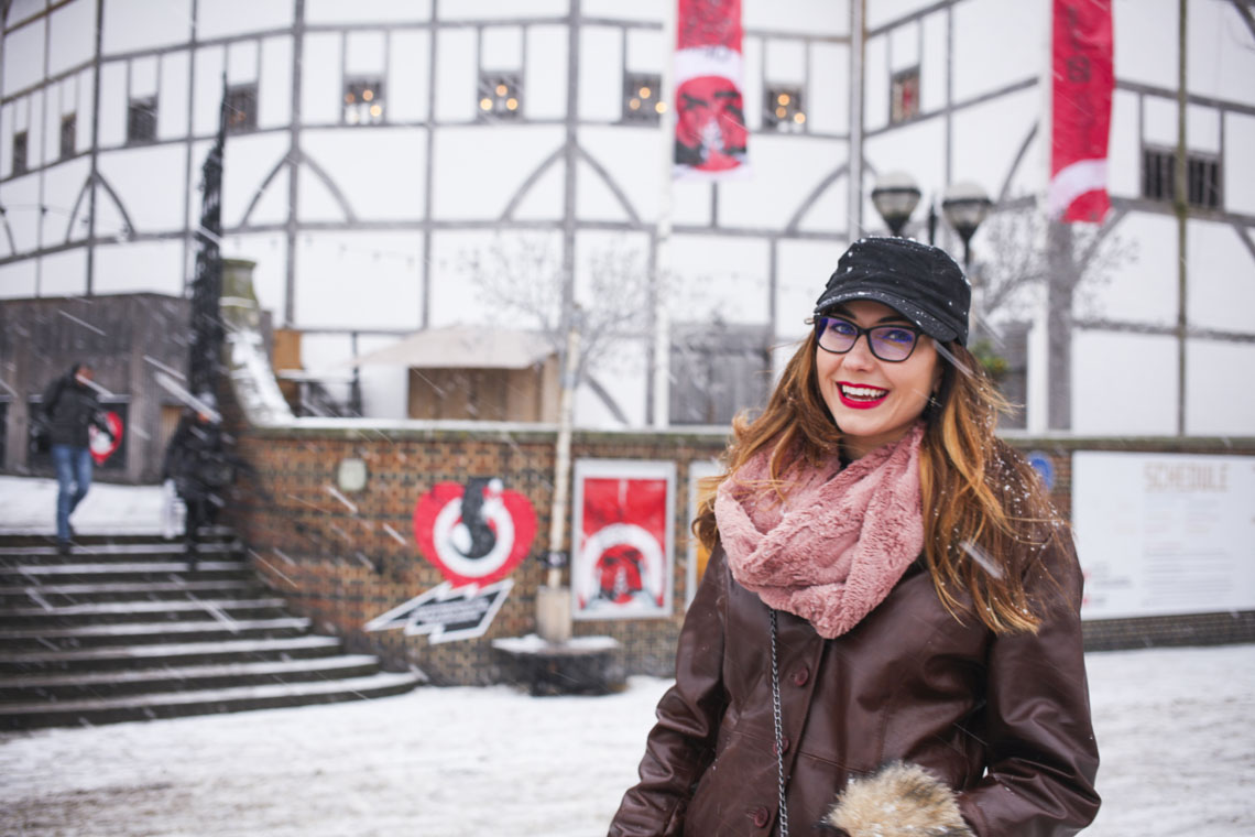 Travel Expert Amy West in front of Shakespeare's Globe in London