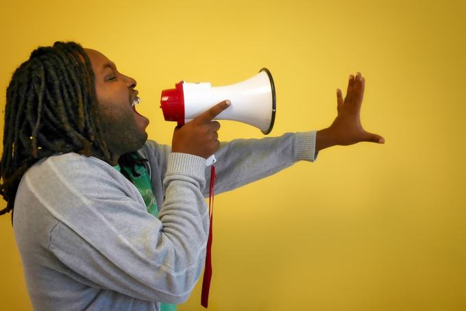 Man Promoting His Message on a Megaphone