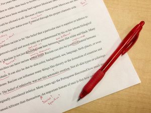 Paper with red editing notations on it to illustrate the editing process.