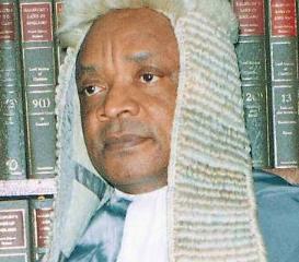 Shocking! Late Justice Innocent Umezulike Makes Buhari's Travel Ban List