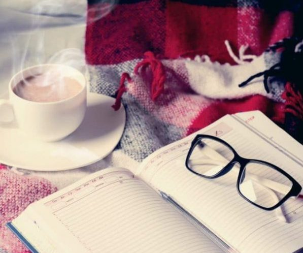 cup-of-cocoa-staying-on-open-book-680x1024