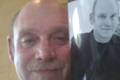 Selfie of Author Mark Lipp and his new book An Addict Within