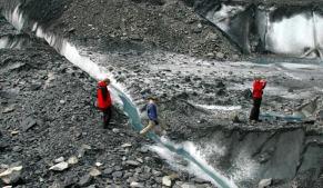 Jumping over crevasse during glacier hike