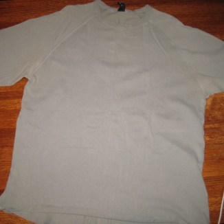 Photograph of sage green knit shirt