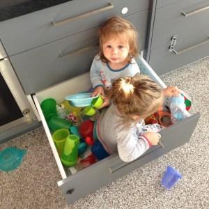 Phoenix and William in kitchen drawer