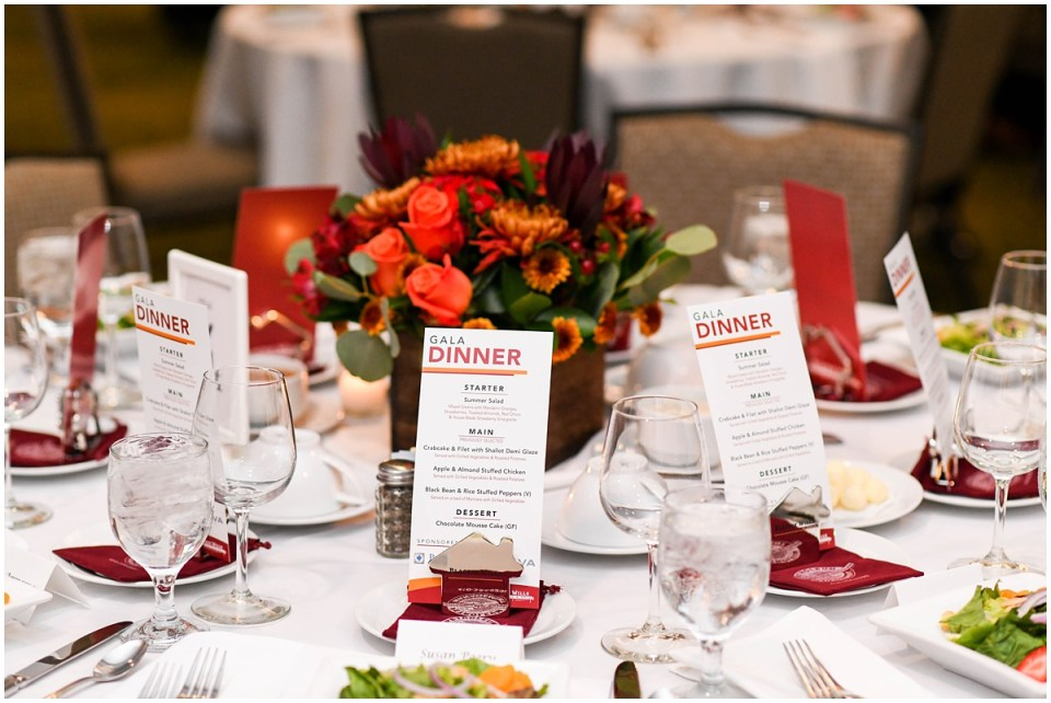 Gala dinner with orange flower centerpieces