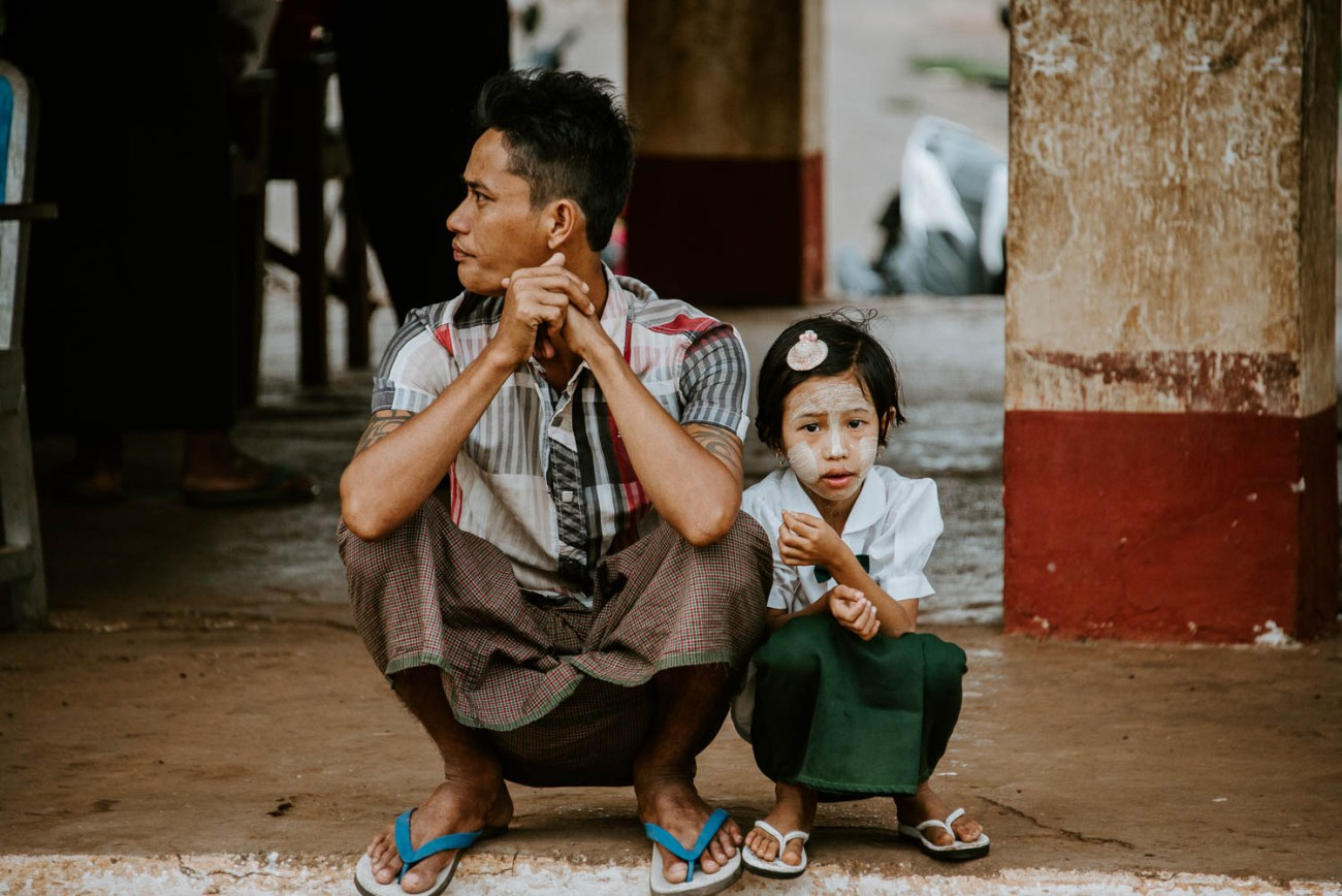 myanmar train station daughter and father