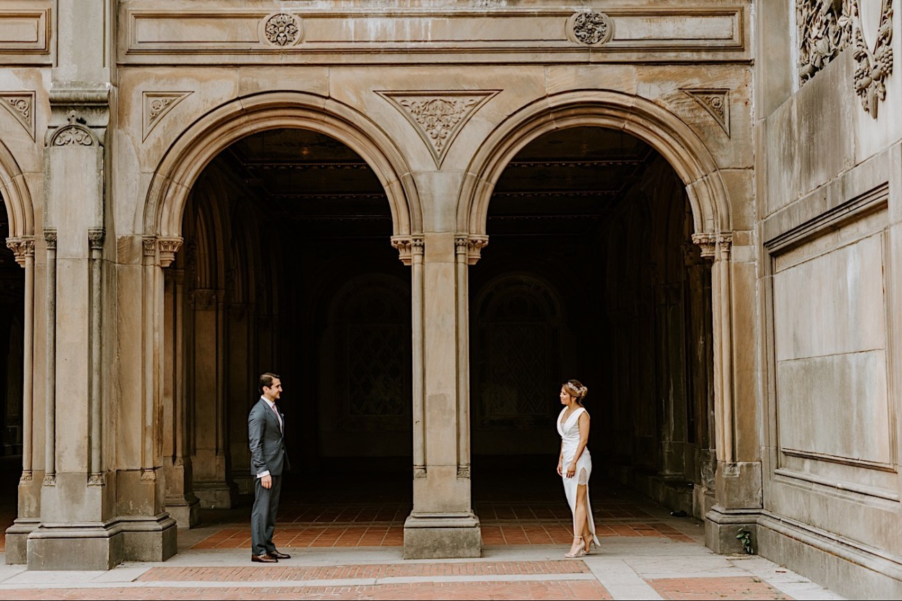 Bride and Groom standing by the Bethesda Terrace in Central Park, Wedding photos in Central Park, Anai sPossamai Photography