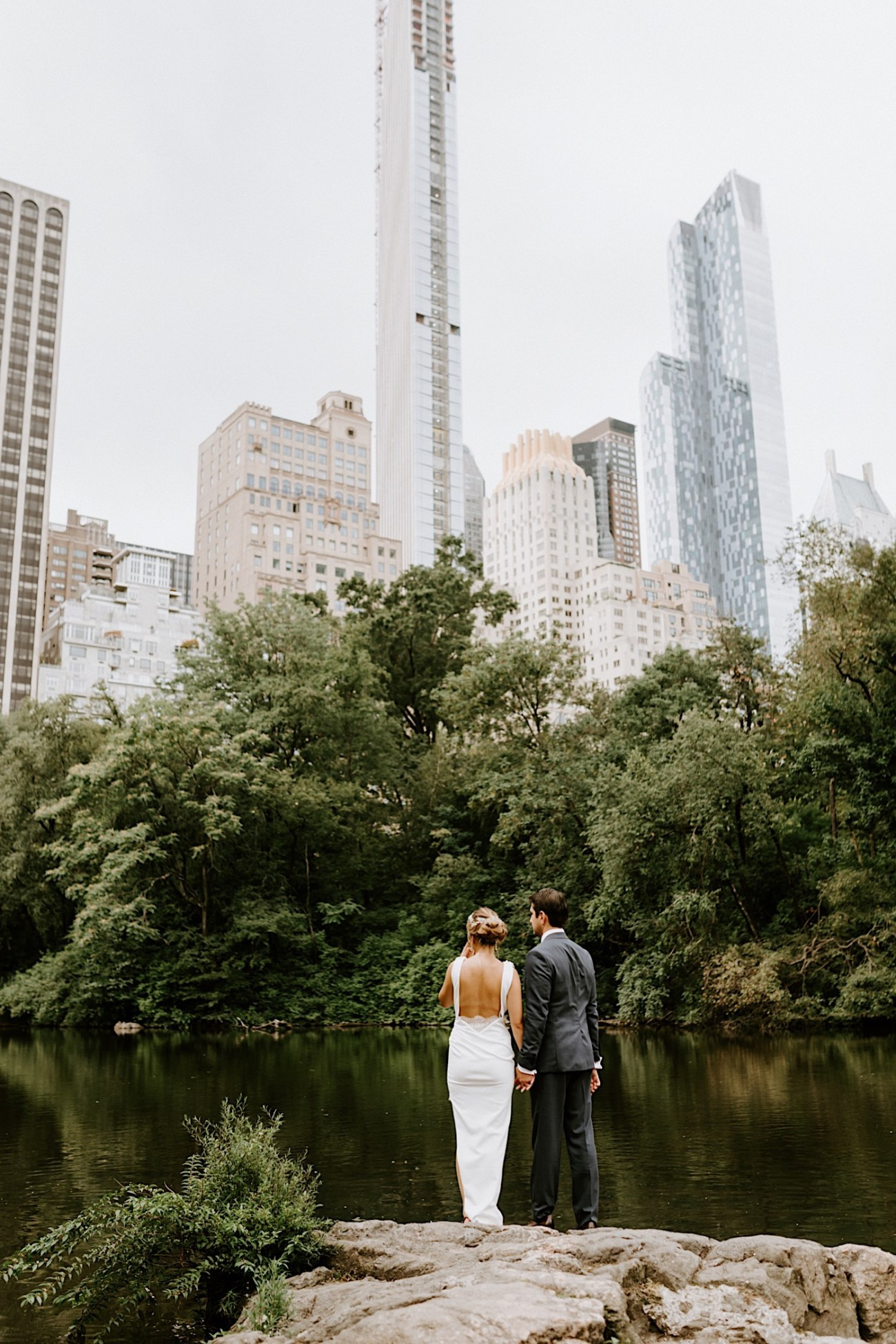 Bride and Groom standing in front of the Manhattan Skyline in Central Park, Best views in Central Park for your elopement wedding portraits, Anais Possamai Photography
